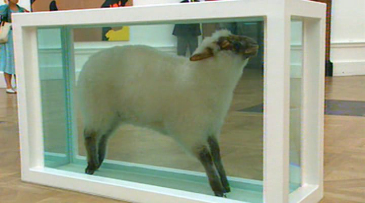 Damien Hirst: Away from the Flock (1994), composed of a dead sheep in a glass tank of formaldehyde
